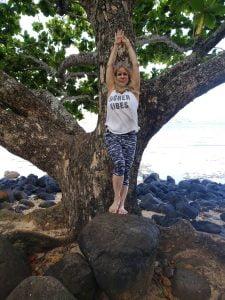 Sylvia Ortiz yoga on rocks by beach